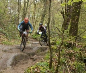 Two people practicing mountain biking
