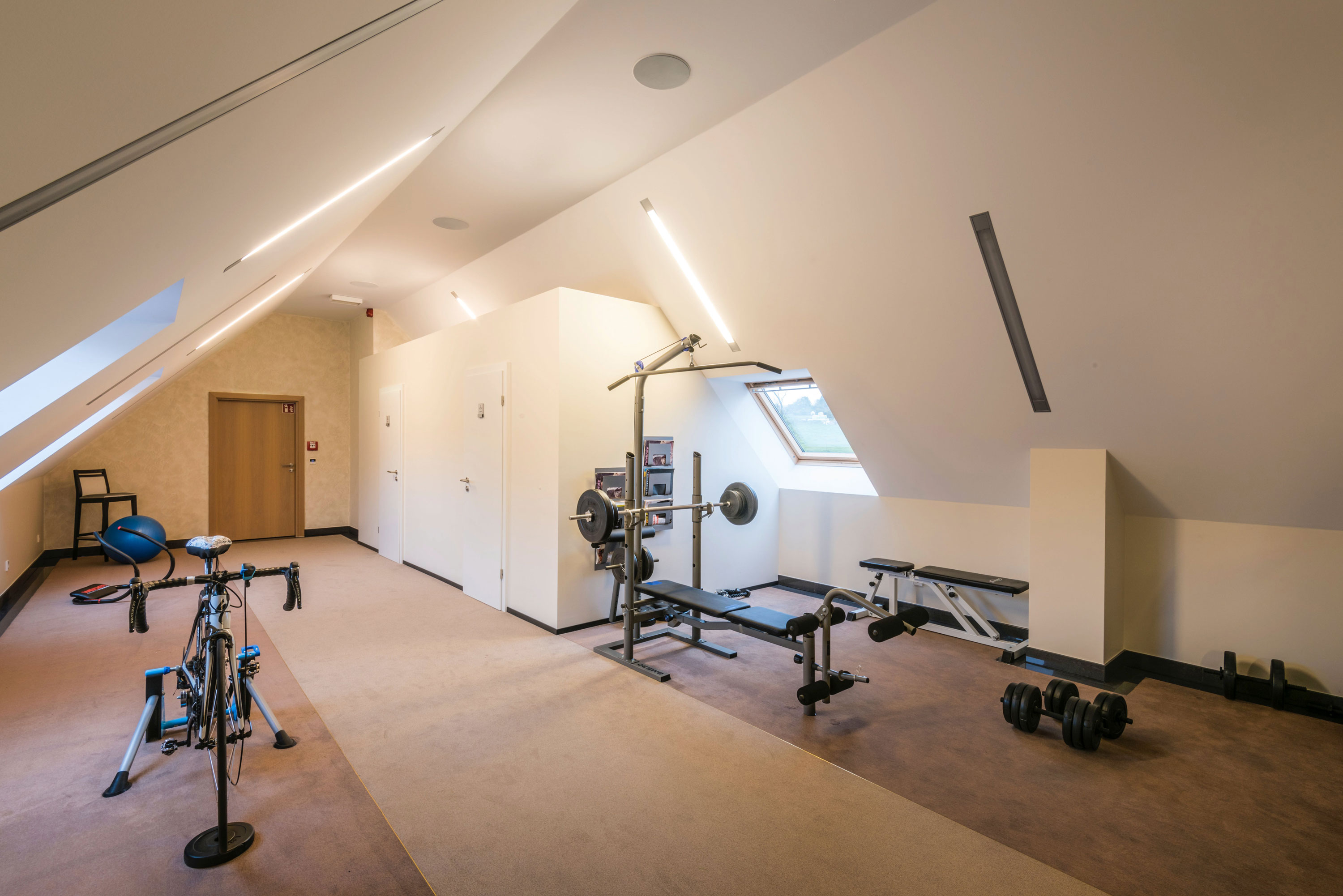 Gym equipment in an attic room