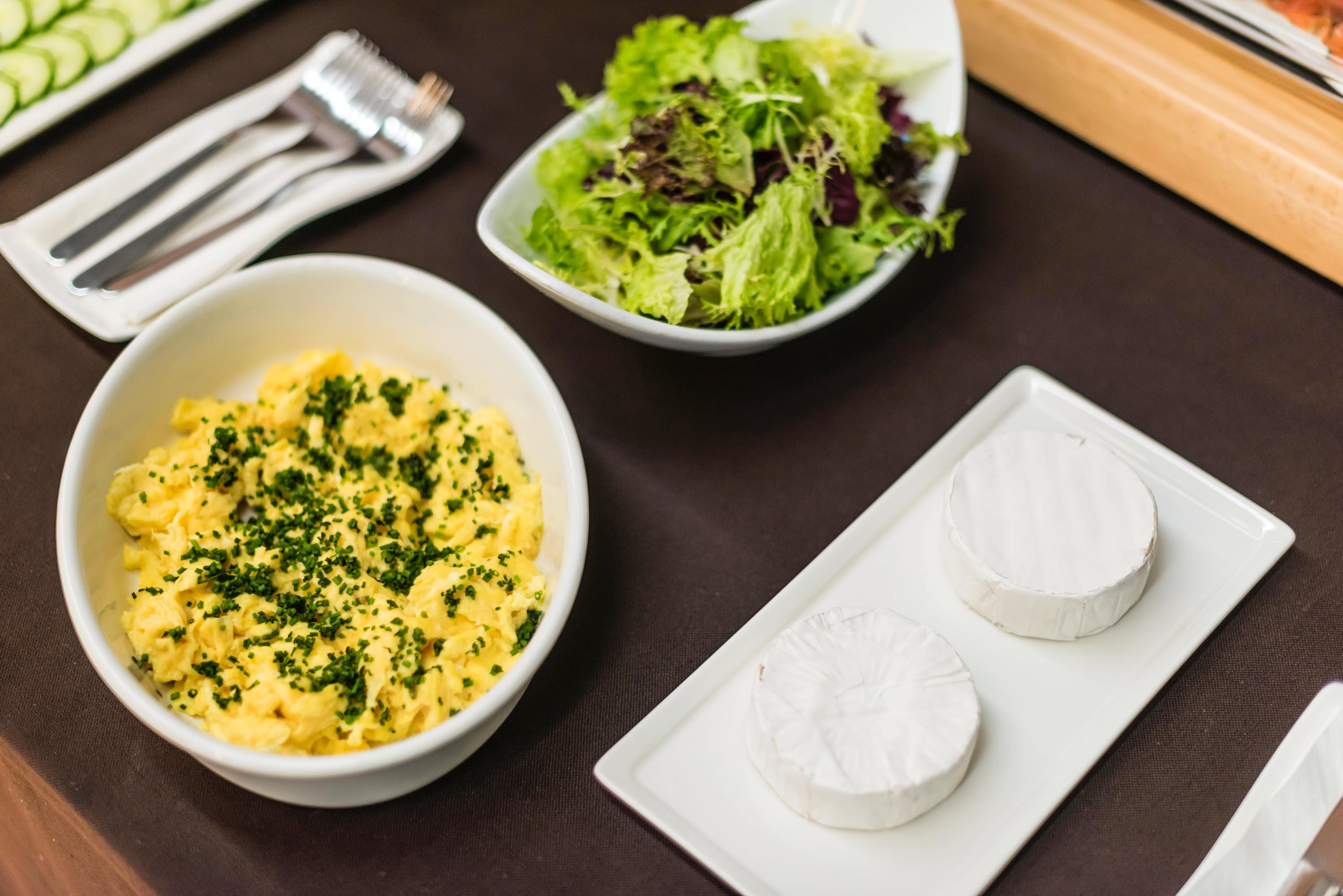 Cheese, scrambled eggs, and salad
