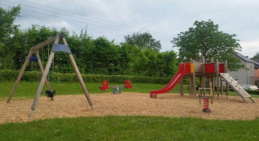 Playground with swings, slide, and seesaw